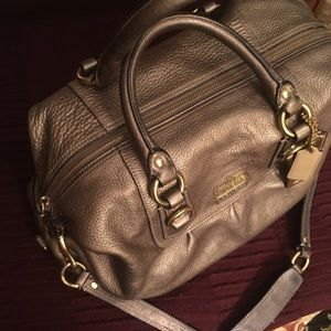 Coach purse satchel converts to hobo bag.